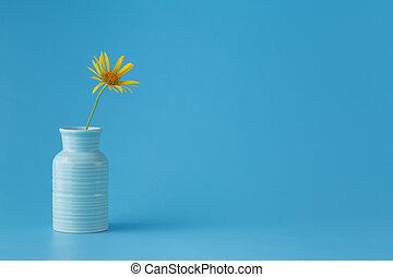 one yellow flower in vase