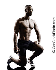 young african muscular build man silhouette - one young...