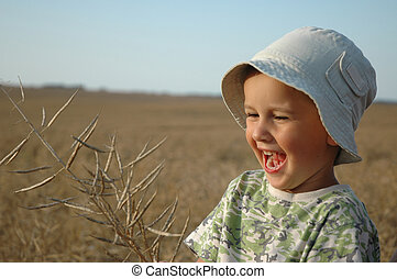 child in field of cereal