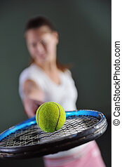 one woman playing tennis sport indoor