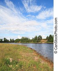 Onega riverbank in sunny day near Kargopol