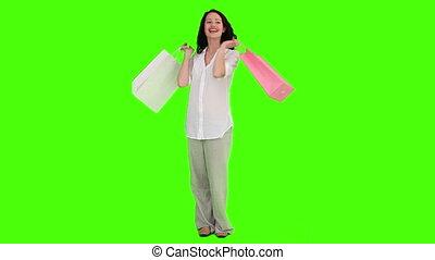 ongedwongen, vrouw, met, het winkelen zakken