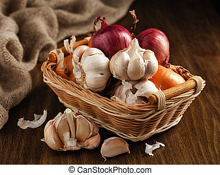 Onion and garlic in a basket on the table