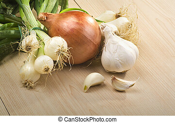 Onion and garlic on the wood