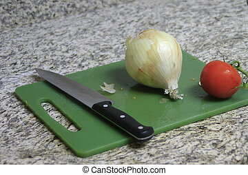 Onion and Tomato on cutting board