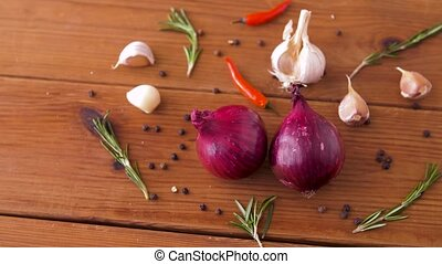 onion, garlic, chili pepper and rosemary on table - food,...