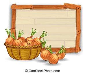 Onion on wooden board