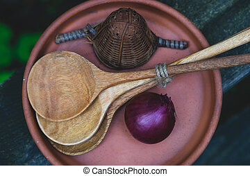 Onion with spoons in a plate