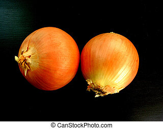 2 isolated onions on black background