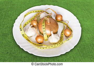 onions and garlics with measure tape