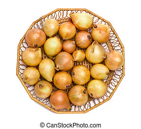 Onions in a wicker vase on a white background
