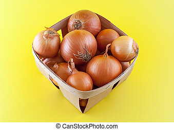 Onions in box on yellow background.