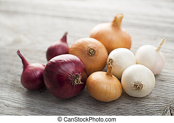 Onions on wooden background close up shoot