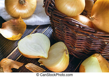 Onions on wooden background