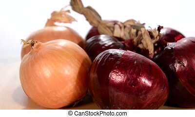 onions rotating over white background