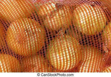 Onions Stored in a Woven Plastic Orange Sack