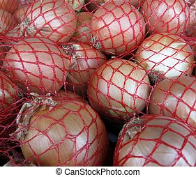 Onions stored in a woven plastic sacks