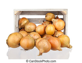 bunch of freshly harvested onions in a wooden crate