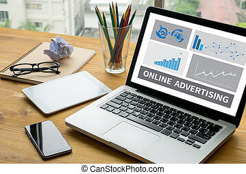 ONLINE ADVERTISING Laptop on table. Warm tone