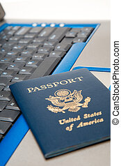 Online booking - A shot of a passport and a laptop, can be...