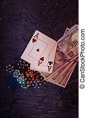 Online casino concept. Dollar banknotes, stucks of gambling chips and aces. Vertical image