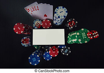 Online casino gambling concept. Smartphone blank screen on chips stack, royal flush poker cards combination and red dices over black table background