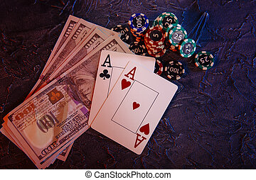 Online casino ?oncept. Dollar banknotes, stucks of gambling chips and aces. Top view