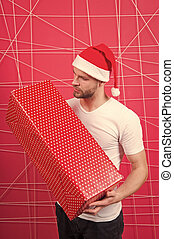 online christmas shopping. Happy new year. delivery christmas gifts. The morning before Xmas. happy santa man. man in santa hat hold christmas present. Christmas composition. Winter holidays sales
