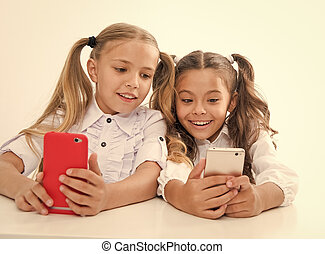 online education for digital children with happy faces. online education. happy childgren with digital devices - smartphones. we are living in digital age