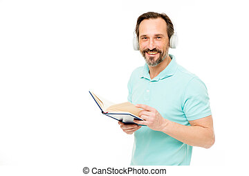 Online education. Man mature bearded guy listening online course. Get more information. Audio book. Reading and listening. Modern education concept. Benefits of online education. Access to knowledge