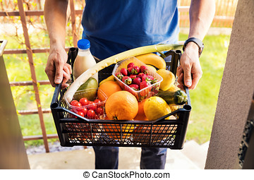 online grocery shopping service concept - delivery man with food box