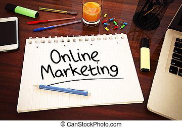Online Marketing - handwritten text in a notebook on a desk...