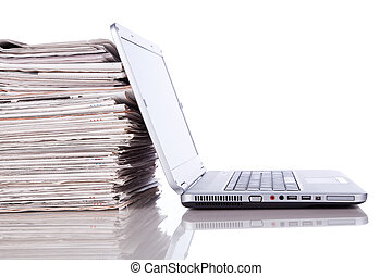 Online News - stack of newspaper next to a laptop (isolated ...