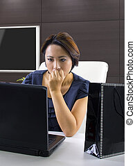 Online Overspending - young woman frustrated because...