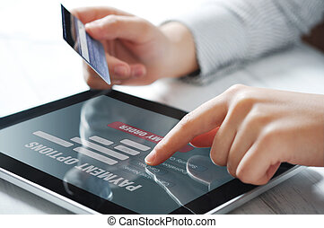 Online payment concept - Female hands using touch screen...