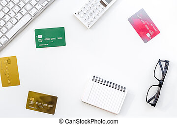 online purchasing with credit cards and notebook on white manager desk background top view mock-up
