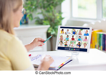 Online remote learning. Teacher with computer.