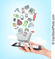 Online shop concept. Female hand holding a phone on which stands empty shopping cart with colorful drawing goods. E-commerce.