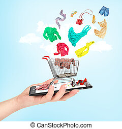 Online shop concept. Female hand holding a phone on which...