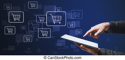 Online shopping addiction concept with man finger on digital tablet touch screen at abstract digital background with shopping cart symbols