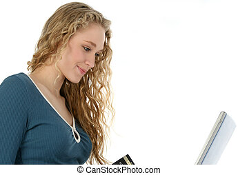 Online Shopping - Beautifull young woman with laptop and...