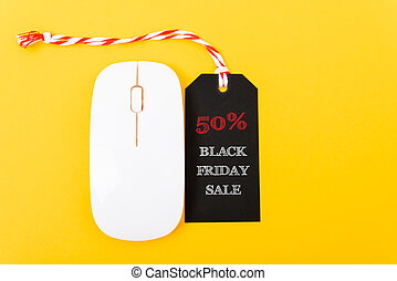 Online shopping Black Friday sale text black tag on white mouse