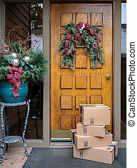 Online shopping boxes by Christmas front door