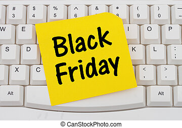 Online shopping on Black Friday, computer keyboard and sticky note