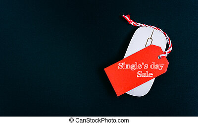Online shopping Single's day sale text red tag on computer mouse