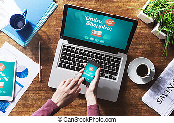 Online shopping website on laptop screen with female hands...