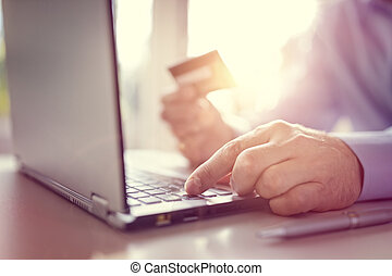 Online shopping with credit card and laptop computer