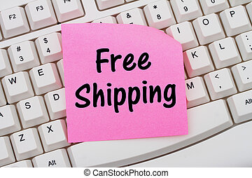 Online shopping with Free Shipping, computer keyboard and sticky note
