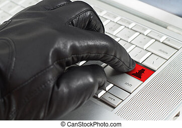 Online spy ware concept with hand wearing black leather...