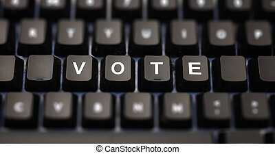 Online voting concept. Vote text written on keypad. Black keys with white letters message for election on pc keyboard. Blur buttons background.